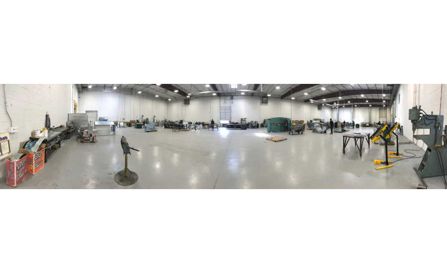 A panoramic view of EMC Mechanical's shop.  A TDC machine, large Pittsburgh machine and a duct liner table are in the background.
