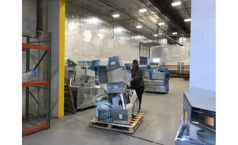 EMC Mechanical's staging area. Once jobs are completed, they are placed on pallets and shrink-wrapped to be ready for pickup/delivery.