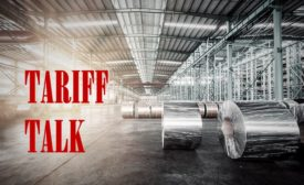 Tariff talk text on a photo of flat rolled steel in a warehouse