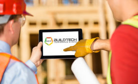 Contractors pointing to iPad with AEC BuildTech logo on the screen