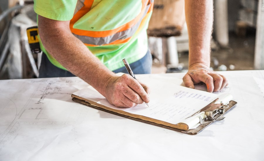 construction worker writing on table top