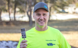 Ron Aho holds the Tinknocker Tool, which he says makes installing cleats faster and easier.