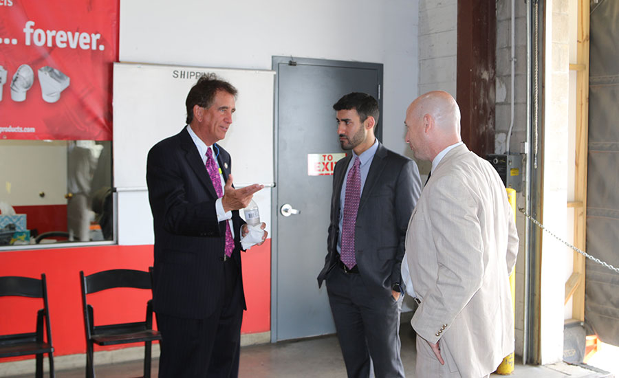 Rep. Jim Renacci (left) speaks with Heating and Cooling Products President Brian Blaushild