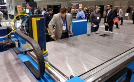 Bryan Timmerman of Mestek Machinery operates the Lockformer Vulcan Laser-Max 1.5 at Mestek's Fabtech booth.