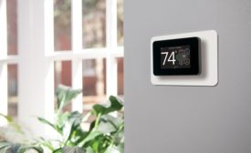 A Johnson Controls touch-screen thermostat.