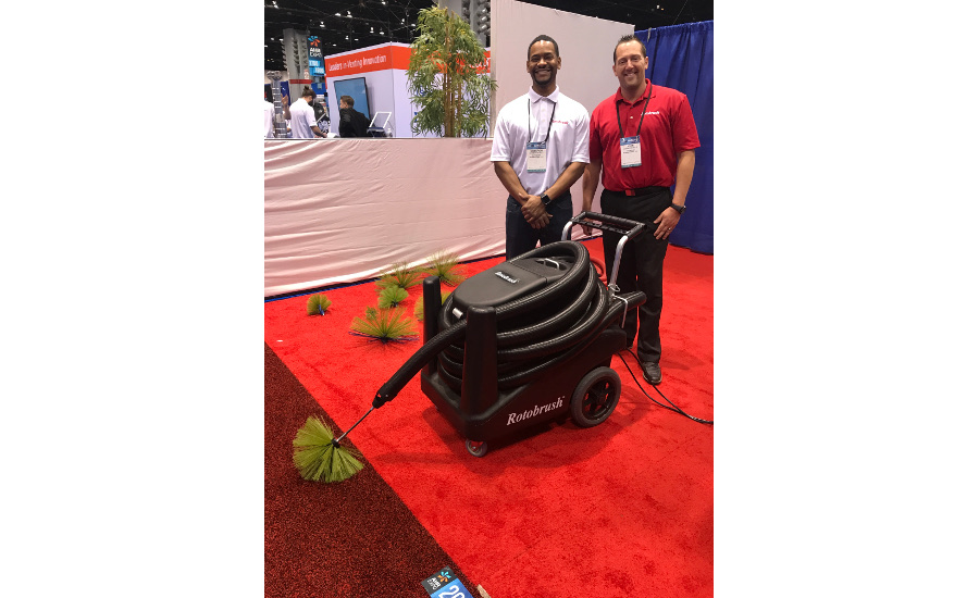 Rotobrush's Cameron Bell (left) and John Kovacs stand with the AirPlusXP duct cleaning machine.