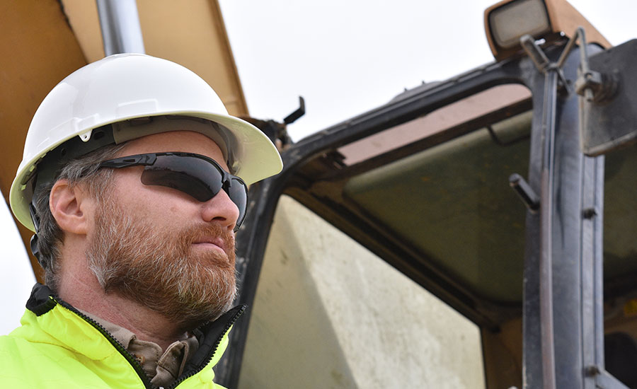 construction worker in safety glasses